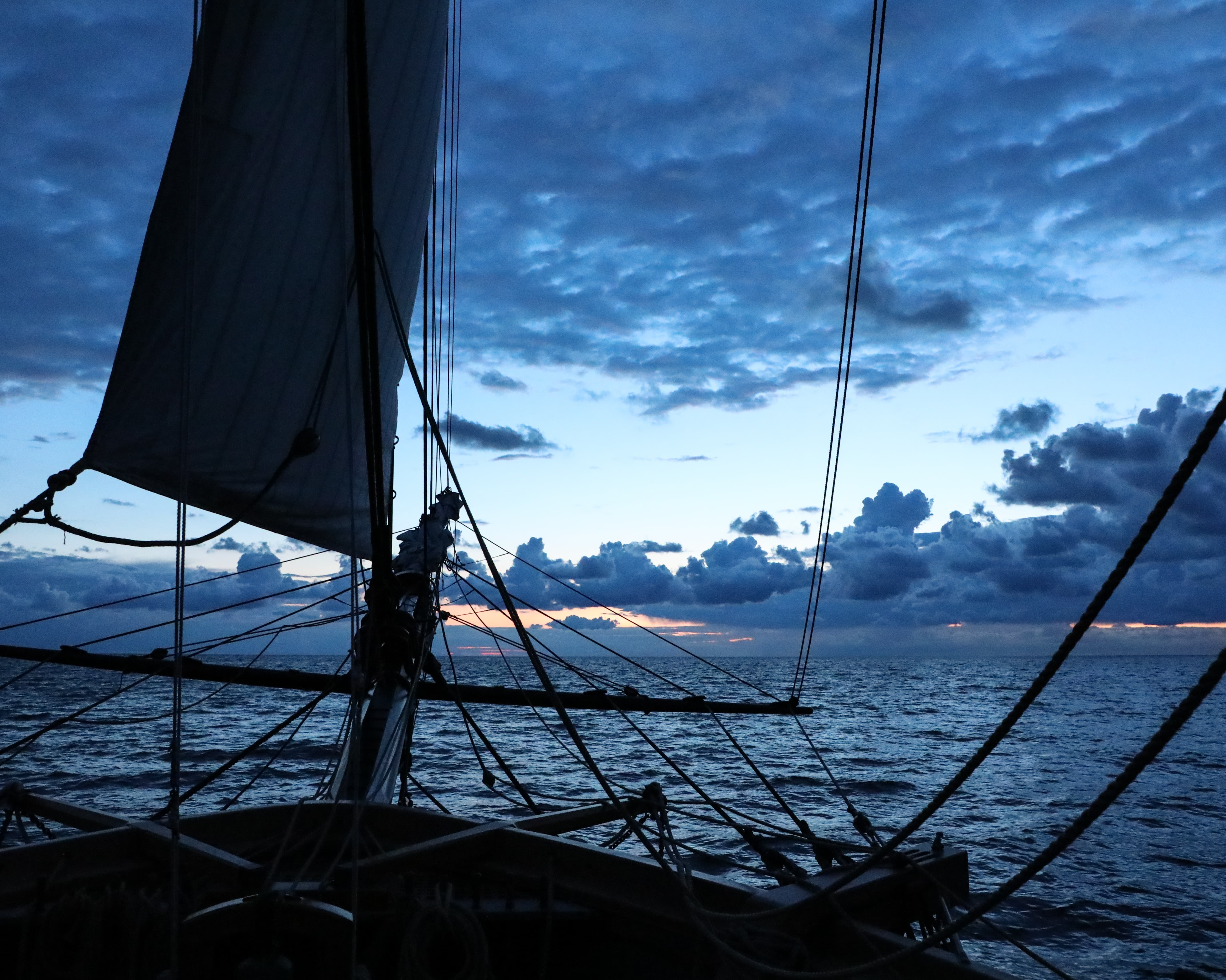 image shows a ship's prow in profile against a seascape at twilight