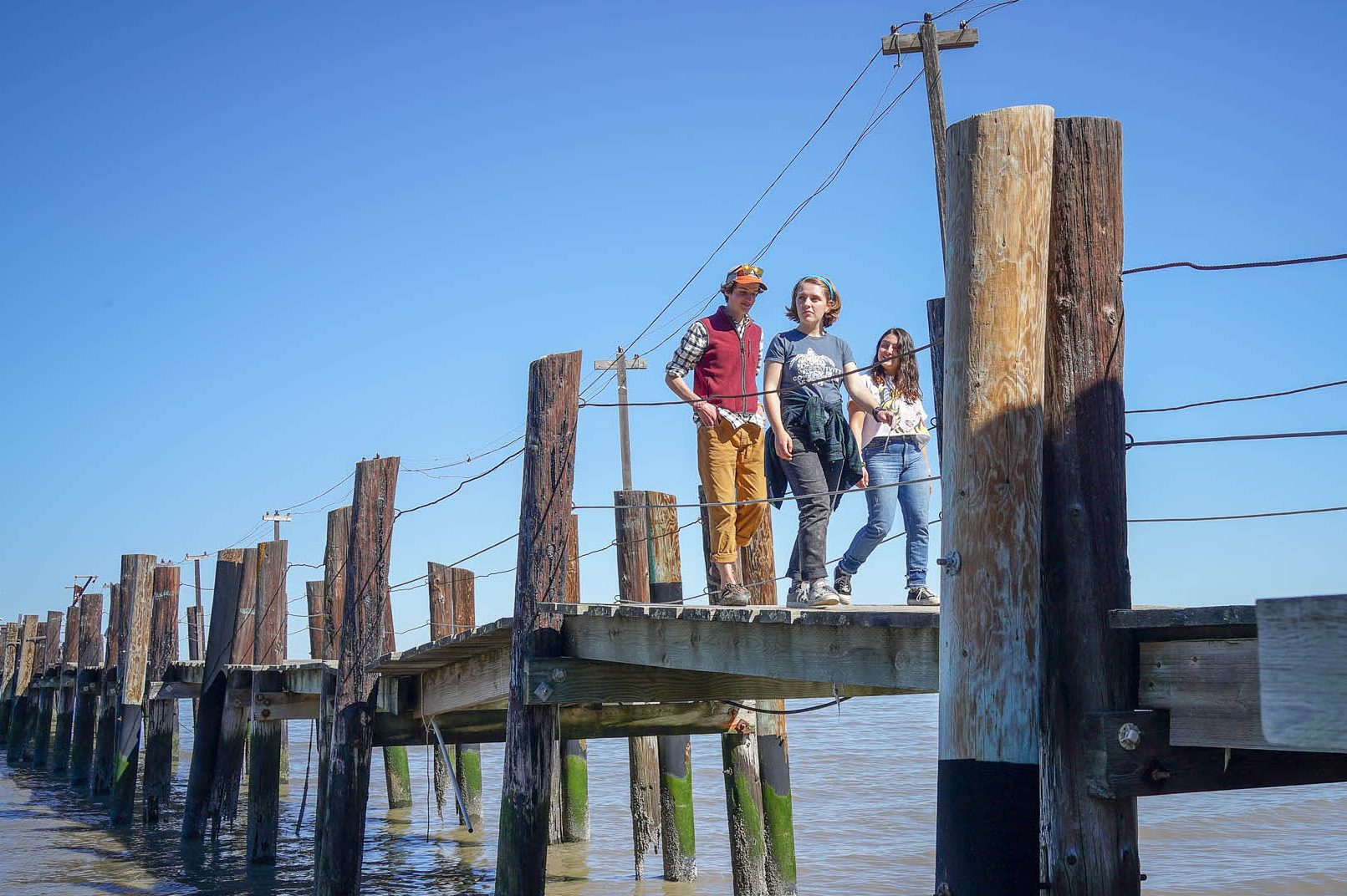 students walk along a dock