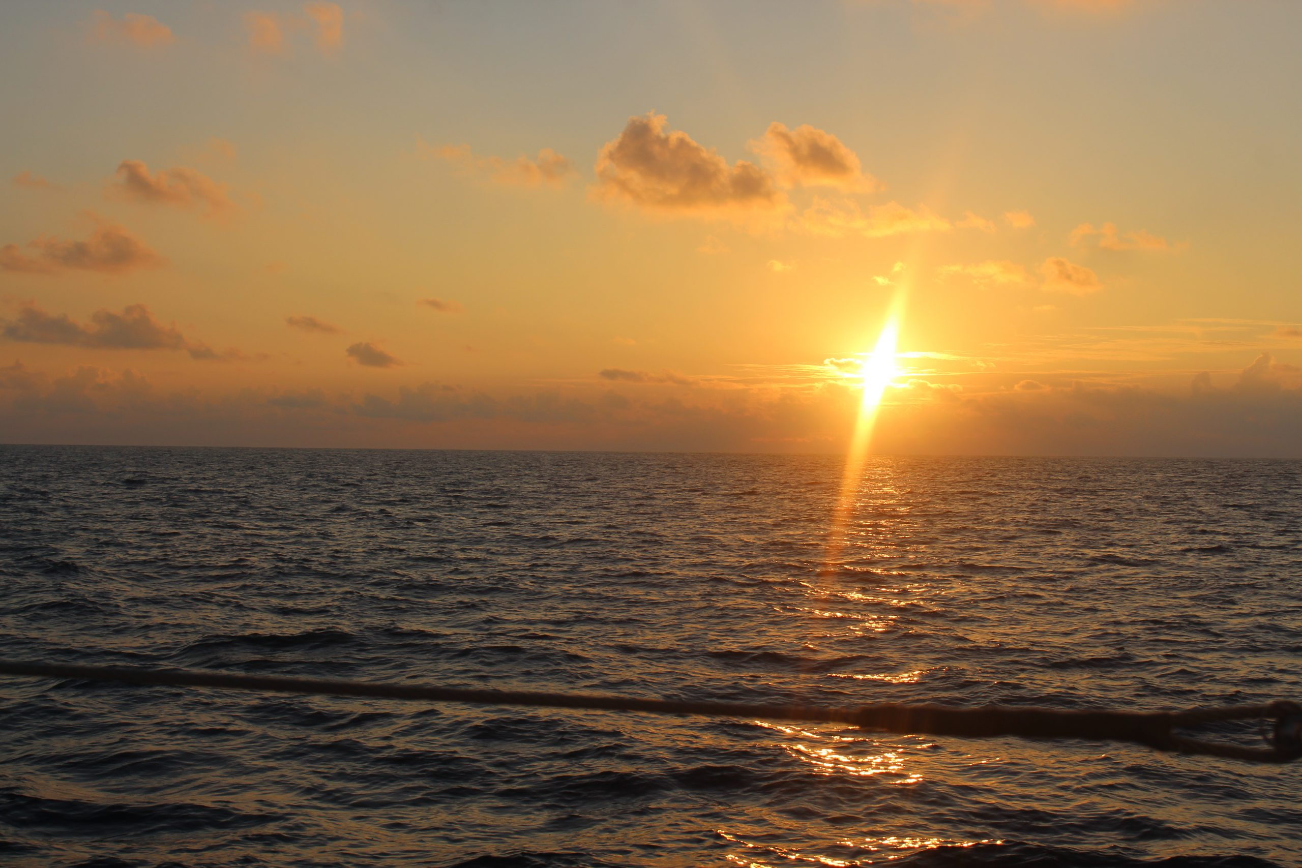 image shows a sunrise over the ocean